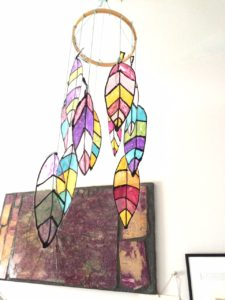 Make a diy faux feather mobile.